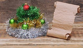 Christmas tree made of tinsel with old paper scroll — Stock Photo