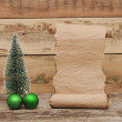 Little toy christmas tree with old paper scroll — Stock Photo #16864399