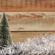 Little toy christmas tree on tinsel — Stockfoto