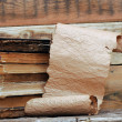 Scrolls of vintage paper with old book — Stock Photo