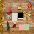 Christmas decoration with old photo frame on the wooden wall - Stock Photo