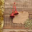 Christmas decoration with blank old paper on the wooden wall — Stock Photo