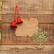 Christmas decoration with blank old paper on the wooden wall — Stock Photo #16865547