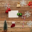 Stock Photo: Christmas decoration and vintage postcad on wood background