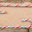 Colorful Candy cane on an old retro paper background — Lizenzfreies Foto