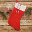 Stock Photo: Christmas stocking on wooden background