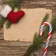 Christmas background with blank old parchment and christmas boot — Stock fotografie