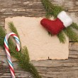 Christmas background with blank old parchment and christmas boot — ストック写真