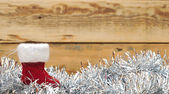 Christmas sock and wreath on wood — Stok fotoğraf