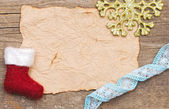Old paper with christmas decoration — Stock Photo