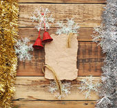 Christmas decoration and vintage paper on the wood background — Zdjęcie stockowe
