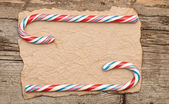 Colorful Candy cane on an old retro paper background — Stock Photo