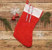 Christmas stocking on wooden background — Stock Photo
