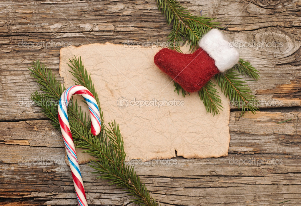 Christmas background with blank old parchment and christmas boot. — Stock Photo #16867239