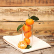 Tangerines in a glass. - Photo