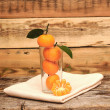 Fresh tangerine and segments in a glass - Foto Stock