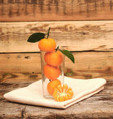 Fresh tangerine and segments in a glass — Stock Photo