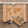 Stock Photo: Old crumpled world map on wooden background