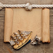 Rope and model classic boat on wood background — Stock Photo #17618391