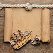 Rope and model classic boat on wood background — Stock Photo