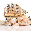 Sailing vessel and sea shells on white background — Stock Photo #17618647