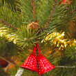 Christmas bells with pine twigs — Stock Photo