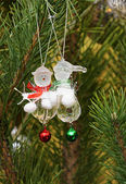Christmas tree branches with snowmans — Stock Photo