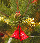 Christmas bells with pine twigs — Stockfoto