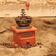 Coffee mill with beans — Stock Photo