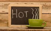 """Word """"hot"""" on chalkboard, written in white chalk — Stock Photo"""