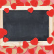 Стоковое фото: Blank chalkboard over Valentine hearts background