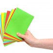 Woman hand holding pile colorful envelopes isolated on white — Stock Photo #19832625