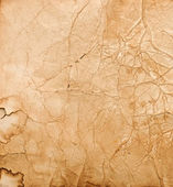 Old paper with stains and scratches — Stock Photo