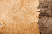 Grunge paper on wooden wall background — Stock Photo