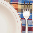 Table setting with fork, knife, plates, and colorful napkin — Stock Photo
