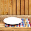 Empty white plate with fork and knife on wooden table — Stock Photo