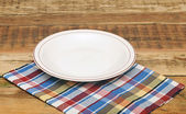 White empty plate on colorful napkin — Stock Photo