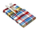 Fork and knife in colorful napkin on the white — Stock Photo