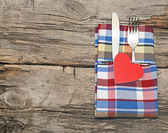 Cutlery set with colorful napkin and heart — Stock Photo