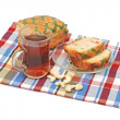 Delicious sweet pie with tea on colorful napkin - Stockfoto