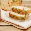 Slice sweet bread with glass tea on wooden background — 图库照片