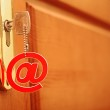 Silver key with e-mail symbol in keyhole isolated over white — Stock Photo #20321425