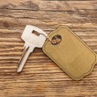 Silver key with blank tag wooden background. space for your text — Stock Photo