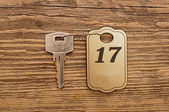 Close up shot of hotel room key shot on wooden background — Stock Photo