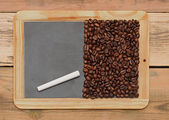 Coffee beans on a blackboard — Stock Photo