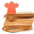 Book stack with paper chef hat shape — Stock Photo #23560703