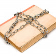 Stock Photo: Old book with chain isolated on white background