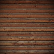 Wooden logs wall of rural house background — Stock Photo