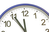 Blue wall clock five minutes to twelve — Stock Photo