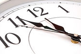 Wall clock five minutes to twelve — Stock Photo